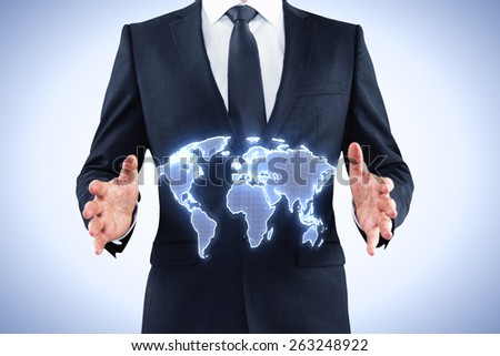 businessman holding digital world map on blue background