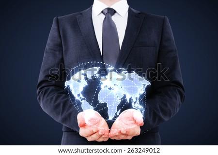 businessman holding digital world map on blue background - stock photo