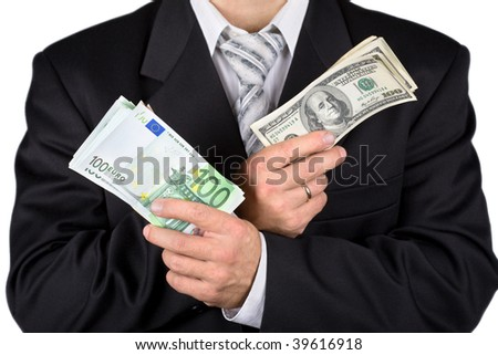 Businessman holding dollars and euros, isolated on white - stock photo