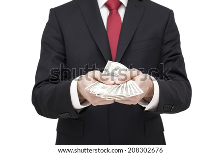 Businessman holding dollars. Clipping path included. - stock photo