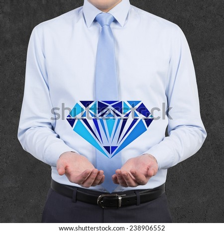 businessman holding drawing blue brilliant - stock photo