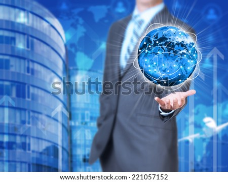 Businessman holding earth. Buildings as backdrop. Element of this image furnished by NASA - stock photo