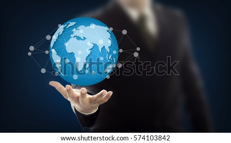 Businessman holding Earth graphic on hand , communication and network internet concept