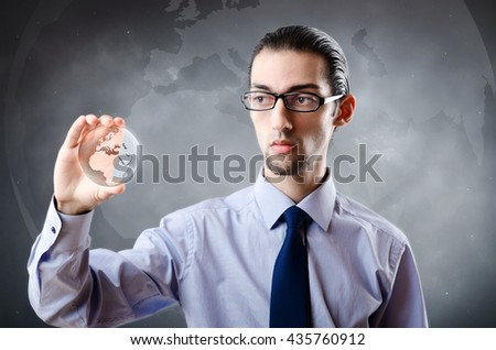 Businessman holding earth in global concept - stock photo