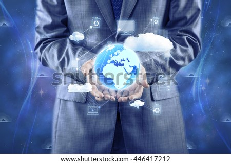 Businessman holding earth in global concept