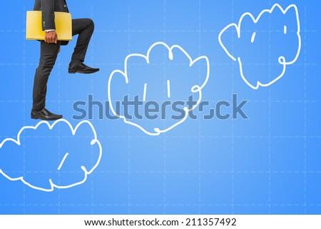 businessman holding files climbing on cloud sky to success - stock photo