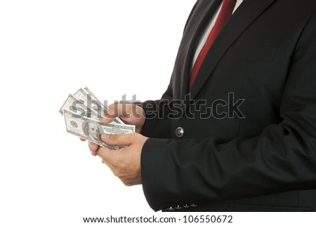 Businessman holding four hundred dollars in his hands - stock photo