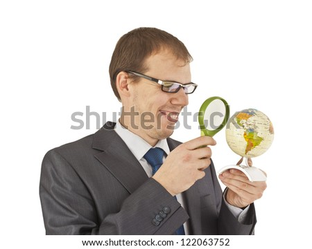 Businessman holding globe - stock photo