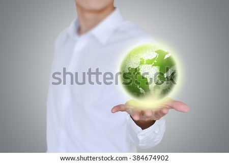 Businessman holding globe.earth in hands.ecology concept. - stock photo