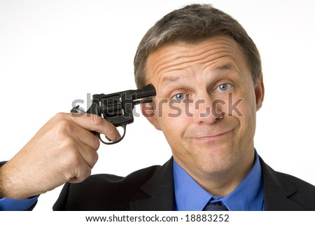 Businessman Holding Gun To Head - stock photo