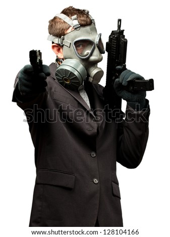 Businessman Holding Gun With Gas Mask On White Background - stock photo