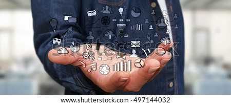 Businessman holding hand drawn web icons in his hand