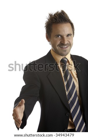 Businessman holding hand for handshake into camera after corporate deal - stock photo