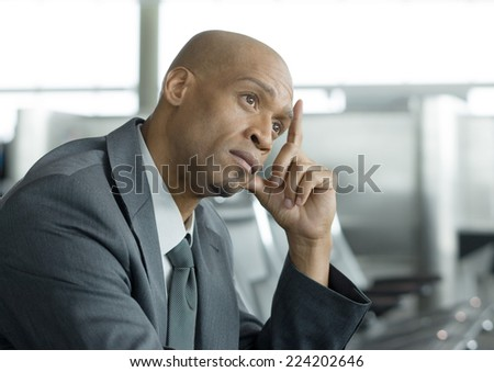 Businessman holding head and thinking - stock photo