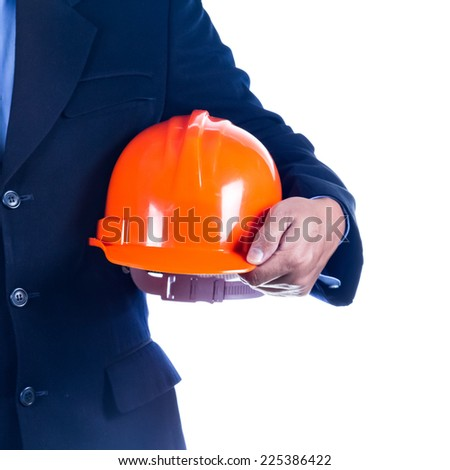 businessman holding helmet on white background - stock photo