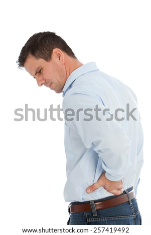 Businessman Holding his Back While Suffering From Back Pain, Isolated on a White Background