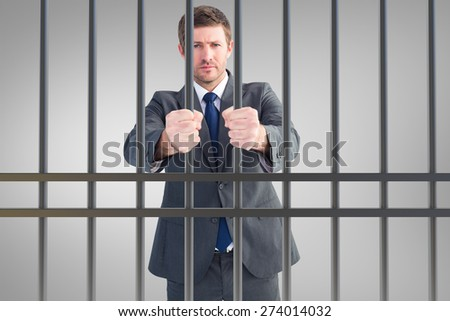 Businessman holding his hands out against grey vignette - stock photo