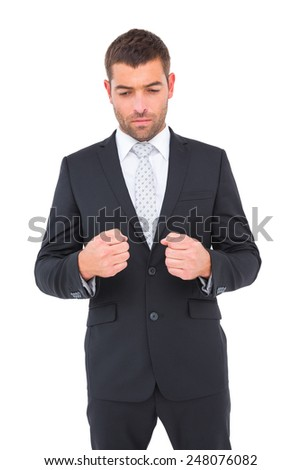 Businessman holding his hands out on white background - stock photo
