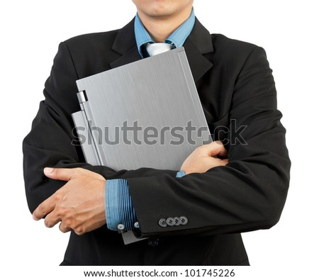 Businessman holding his laptop - stock photo