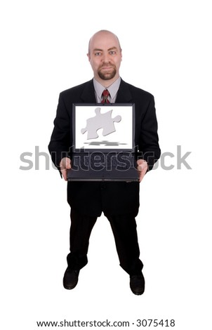 Businessman holding his laptop with a puzzle piece on the screen isolated over white with a clipping path - stock photo