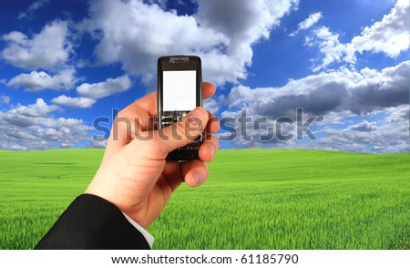 Businessman holding his mobile phone - stock photo