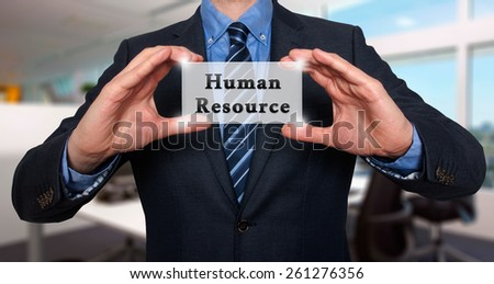 Businessman holding Human Resource sign. Office - Stock Photo - stock photo
