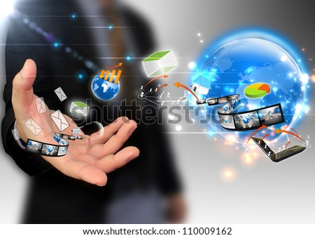 businessman holding ideas around the world social media - stock photo