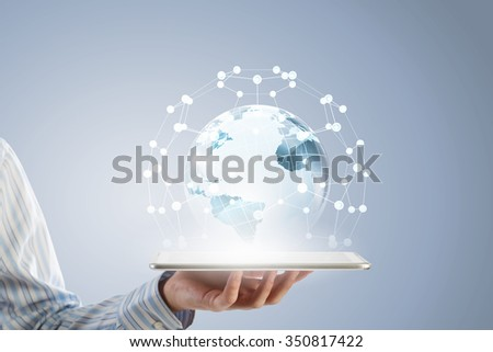 Businessman holding in hand tablet with global connection concept - stock photo