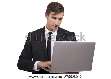 Businessman holding laptop in hands isolated - stock photo