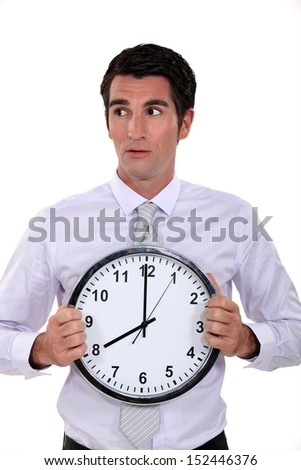 Businessman holding large clock - stock photo