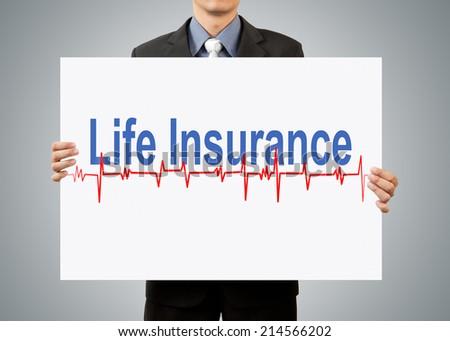 businessman holding life insurance concept - stock photo