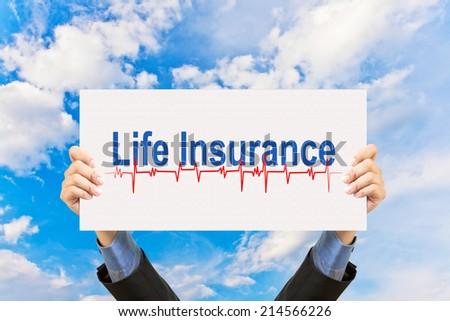 businessman holding life insurance concept and blue sky - stock photo