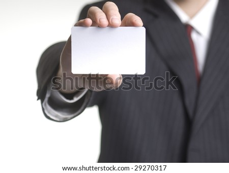 Businessman holding little white card in his hand