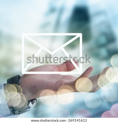 Businessman holding mail envelope - stock photo