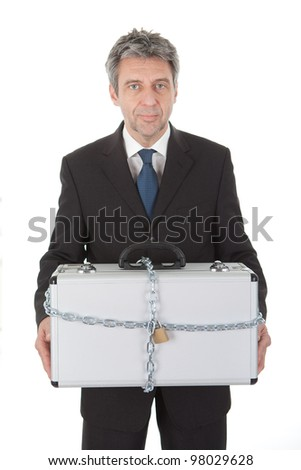 Businessman holding metal suitcase with chain and lock. Isolated on white