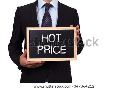 Businessman holding mini blackboard with HOT PRICE message