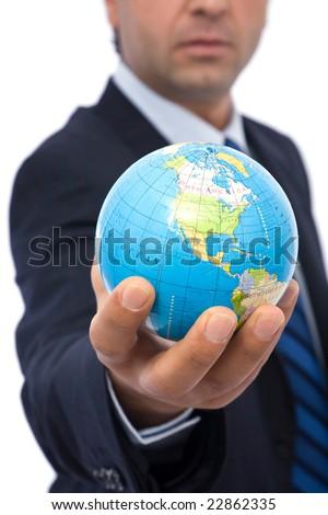 businessman holding mini globe on white background - stock photo