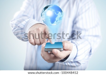 Businessman holding mobile phone with 3D Globe. Concept for connectivity, internet, and communication - stock photo