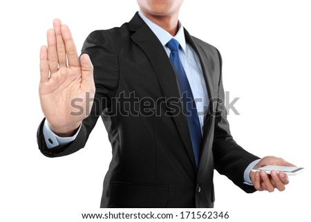 businessman holding mobile smart phone, while another hand touching to virtual touch screen - stock photo