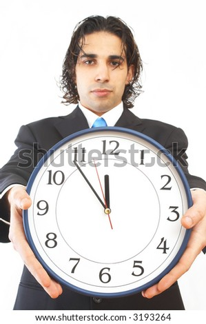 businessman holding modern clock on white, shallow dof - stock photo