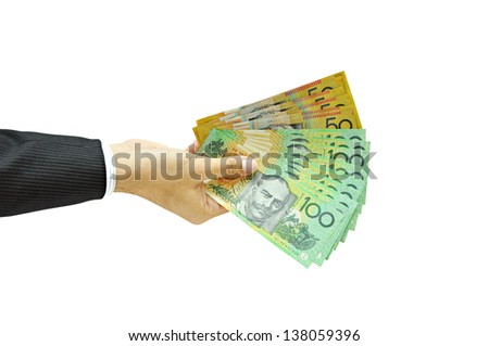 Businessman holding money - Australian dollars - stock photo