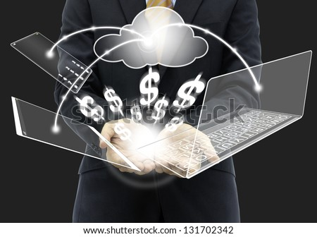 Businessman holding money with cloud computing solution - stock photo