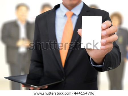 Businessman holding or showing blank business card isolate on white background. - stock photo
