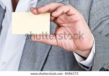 businessman holding out a blank business card. - stock photo