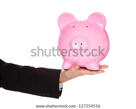 Businessman holding out a piggybank. Isolated on white - stock photo