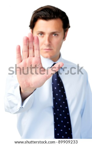 Businessman holding out his hand to show 'stop!' - stock photo