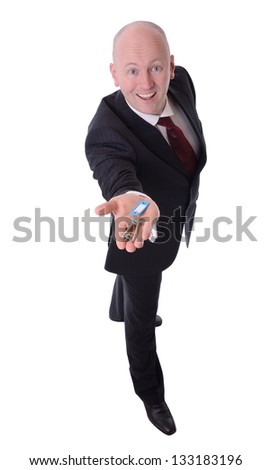 businessman holding out keys isolated on white background - stock photo