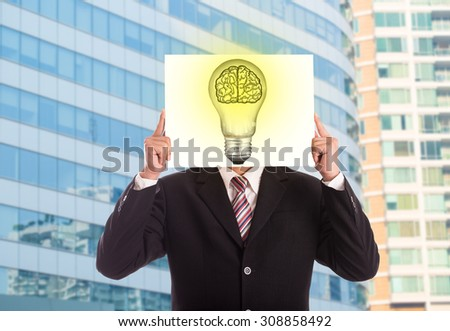Businessman holding paper Idea lamp creative business