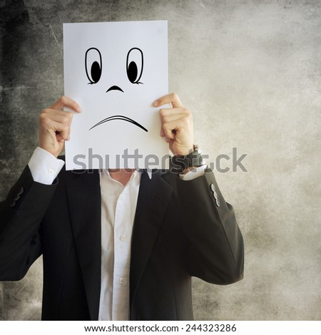 Businessman holding paper with face expression - stock photo