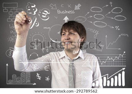 businessman holding pen and drawing graphics